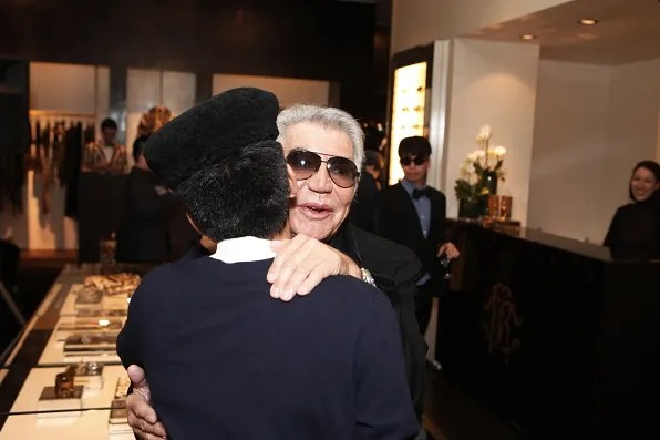 Bryanboy and fashion designer Roberto Cavalli hugging at the Roberto Cavalli store in Tokyo
