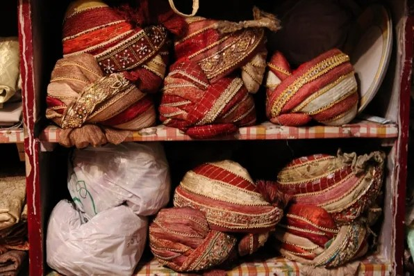 A cabinet filled with turbans