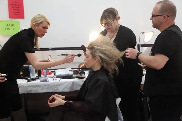 A model getting her hair done by Sebastian stylists