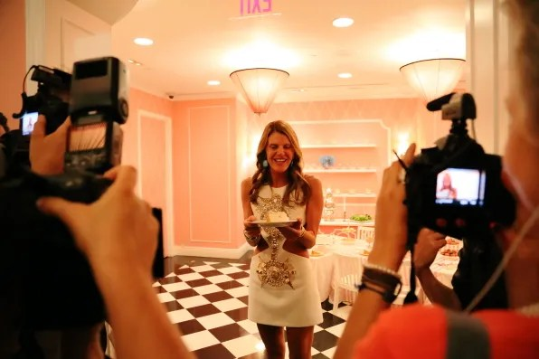 Vogue Japan editor Anna dello Russo holding a slice of cake at The Plaza hotel, New York