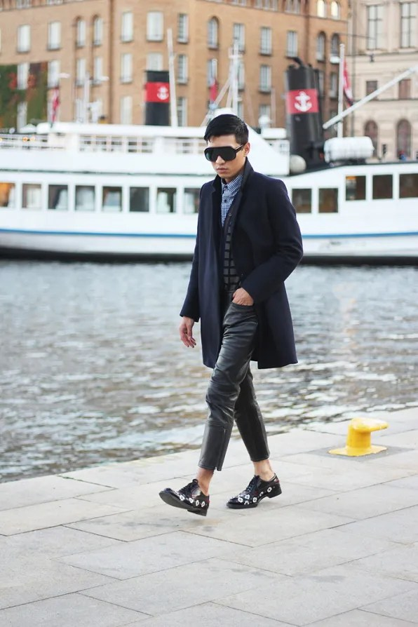 Bryanboy wearing leather Acne pants in Stockholm