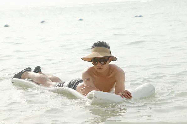 Bryanboy wearing Marc by Marc Jacobs swimming trunks on the beach