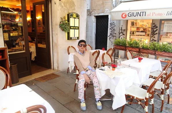 Bryanboy at a cafe in Venice, Italy