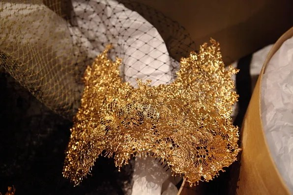 Gold headpieces by Suzy O'Rourke