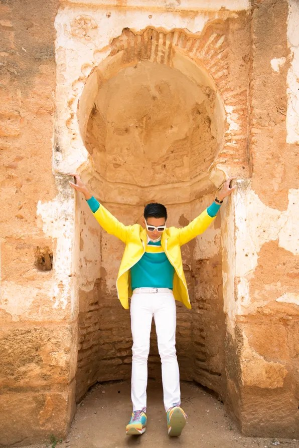 Bryanboy wearing a Ferragamo jacket and sweater at Kasbah Chellah in Rabat, Morocco
