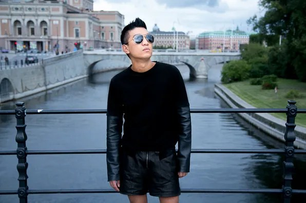 Bryanboy wearing a leather-sleeved COS top in Stockholm