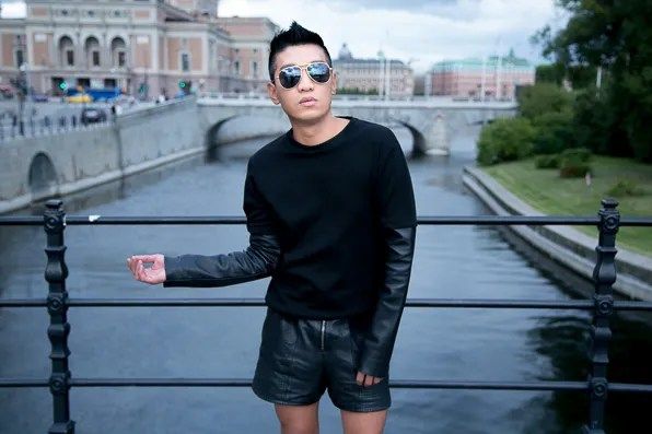 Bryanboy wearing a pair of Saint Laurent aviator sunglasses