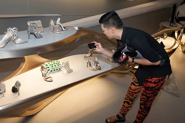 Bryanboy taking photos inside the Stuart Weitzman boutique in Milan