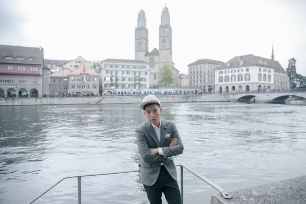 Bryanboy standing in front of a lake in Zurich city center