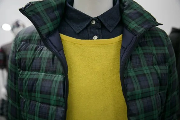 Close up view of plaid puffy jacket by Uniqlo Lifewear fall winter 2013 with yellow cashmere sweater