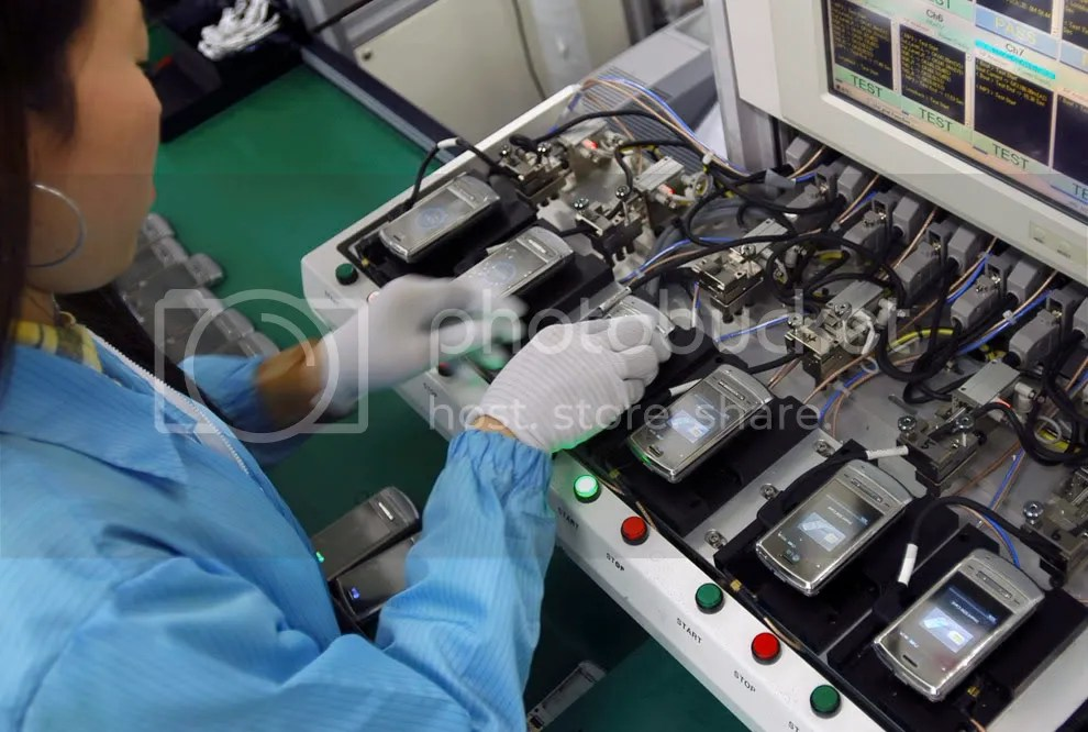An employee works at a mobile phone assembly line at a LG Electronics plant in Pyeongtaek, south of Seoul, South Korea in this picture released on January 22, 2009. (REUTERS/LG Electronics/Handout