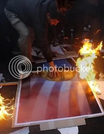 Iranians burn posters of Obama