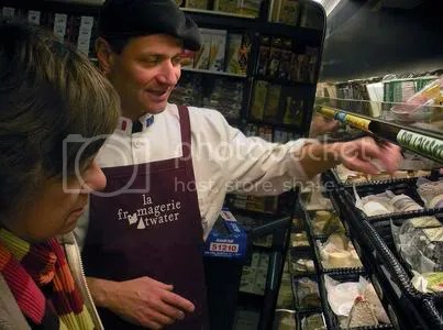 Cheesemonger at Montreals Fromagerie Atwater. Toronto Star photo by Andrew Chung