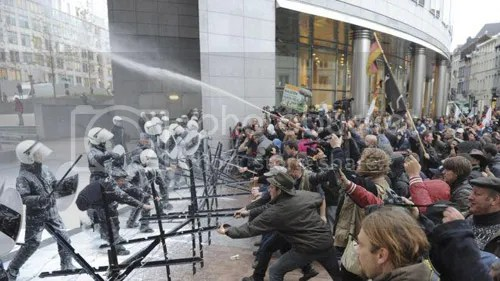 Farmers spray milk at riot police in Brussels, pic via Fox News.