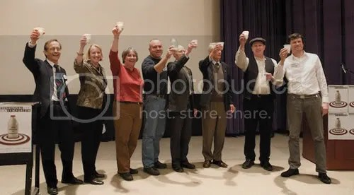 Event speakers raise a toast to celebrate the successful conclusion of Saturdays raw milk symposium.