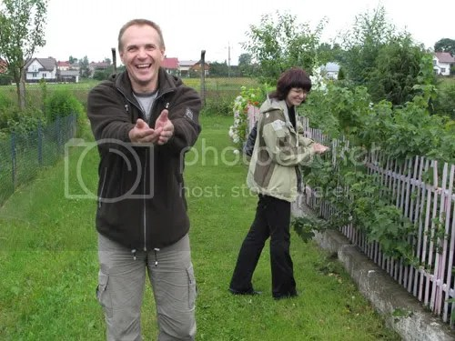 My cousin and his wife in the green lane next to her familys garden plot in Poland.