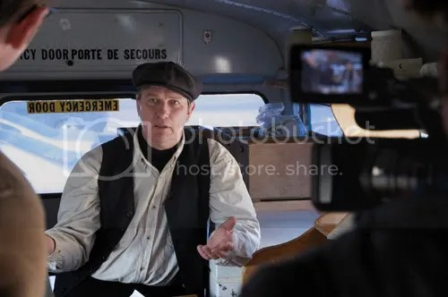 Raw milk farmer Michael Schmidt talks to A-Channel reporters on camera in the blue bus, March 2009