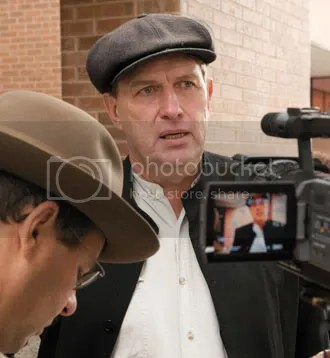 Is this man a criminal? Farmer Michael Schmidt talks to media outside the Newmarket court house October 20th.