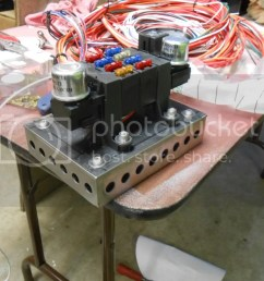 this is the mount that i made for my voltage regulator starter relay and my junction boxes for my power and ground leads that will go to the battery in the  [ 1024 x 768 Pixel ]