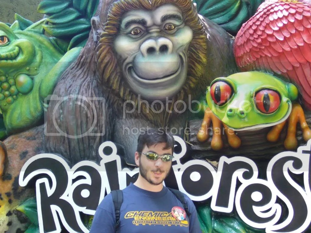 Chris in front of the Rainforest Cafe sign. We didnt eat there, but we thought the gorilla looked like he was making our silly face, so he posed with it.
