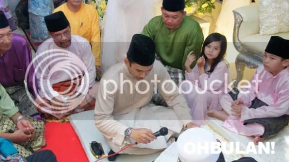 gambar pernikahan norman hakim memey suhaiza