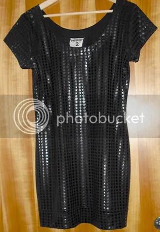 Svart klänning med gummistjärnor strl L, 30 kr på second hand. Ska få flytta till Hanna :-)