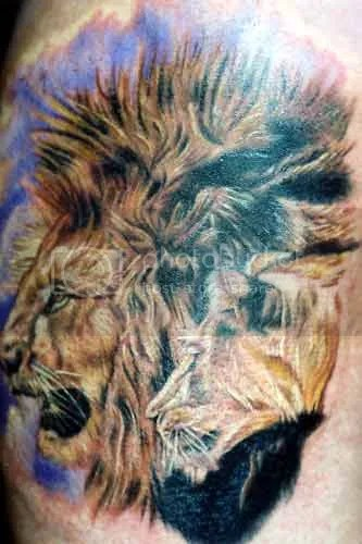 Tiger Eyes On Shoulder Tattoo Design