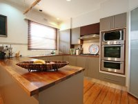 Modern u-shaped kitchen design using floorboards - Kitchen ...