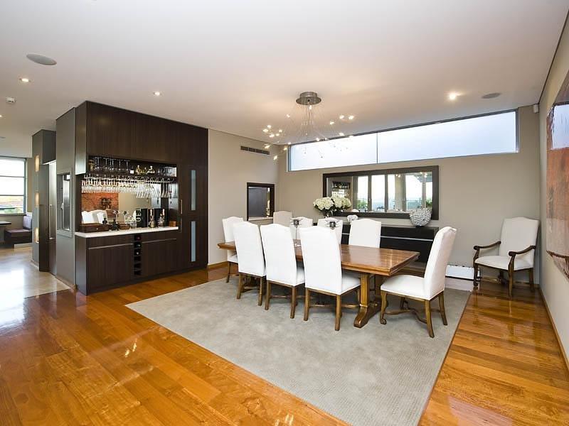 Modern dining room idea with floorboards  barwine bar