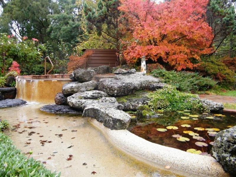 Garden Design Using Grass With Fish Pond & Rockery Gardens Photo