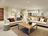 Open plan living room using white colours with tiles ...