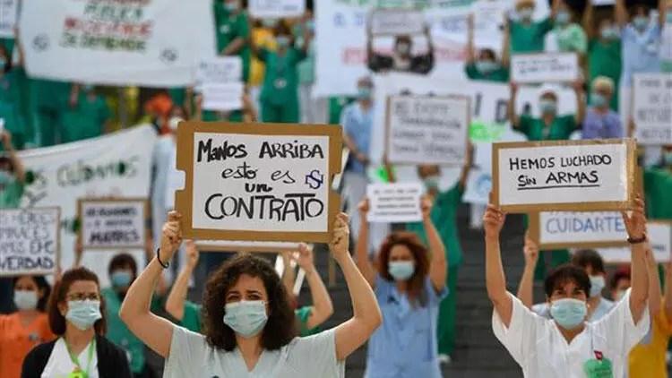İspanya'da sıhhat çalışanları çalışma kurallarını protesto etti 1