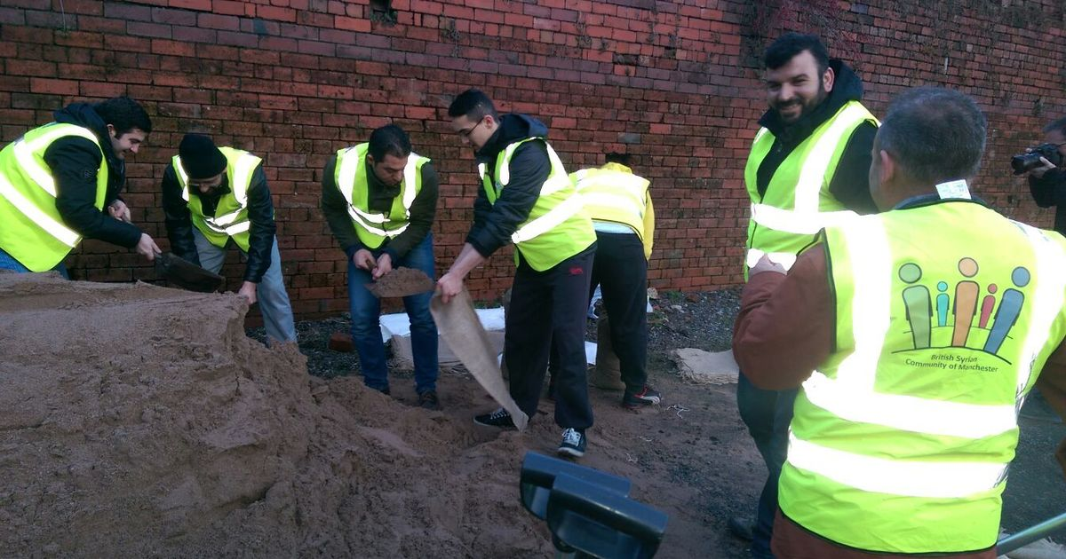 Syrian refugees given asylum in Greater Manchester pitch in with Rochdale flood defence efforts