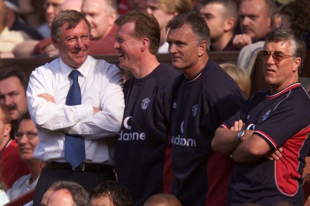 Ferguson and his staff in 2000.