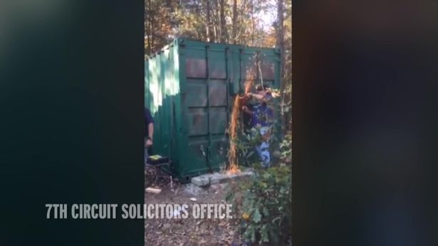 Inspectors cut their way into the shipping container to rescue Kala Brown