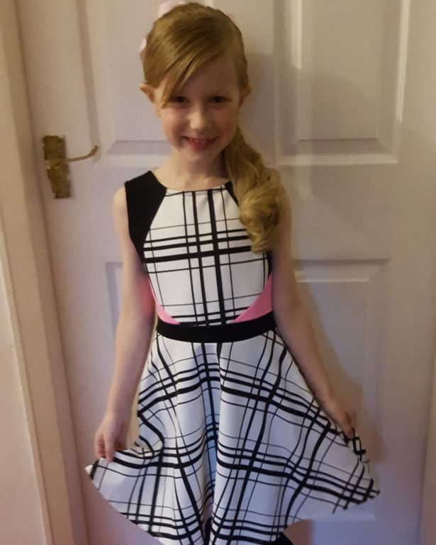 Tegan is seen on her first outing as a girl earlier this year, wearing a dress and with extensions in her hair