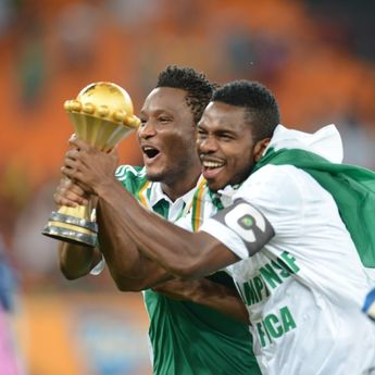JOHANNESBURG, SOUTH AFRICA - FEBRUARY 10: John Obi Mikel celebrates holding the trophy during the 2013 Orange African Cup of Nations Final match between Nigeria and Burkina Faso from the National Stadium on February 10, 2013 in Johannesburg, South Africa. (Photo by Lefty Shivambu / Gallo Images/Getty Images)