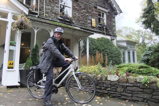 Charged: Nigel ready for his trip on an electric bike