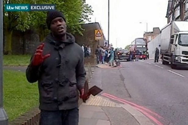 Raving: Michael Adebolajo after Woolwich attack