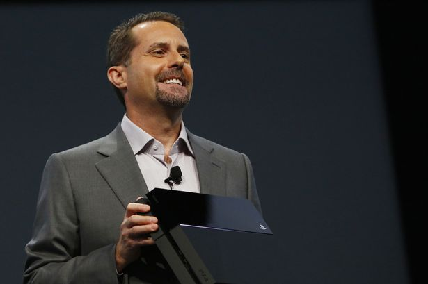 Sony Computer Entertainment CEO Andrew House with the Playstation 4