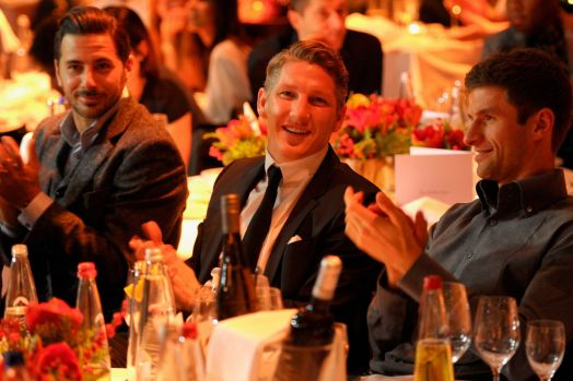 Claudio Pizarro (L-R), Bastian Schweinsteiger and Thomas Mueller attend the FC Bayern Muenchen Christmas Party at Schubeck's Teatro restaurant on December 7, 2014 in Munich, Germany.