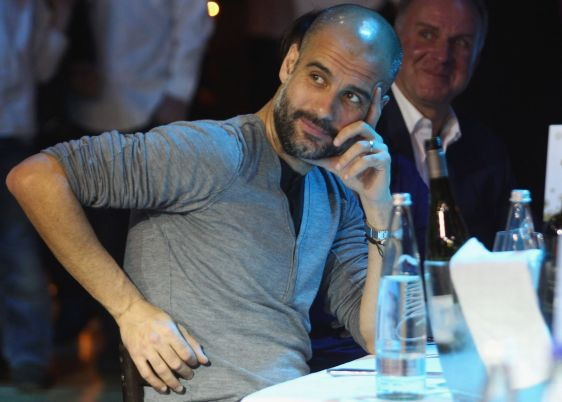 Team coach Josep Guardiola (L) and CEO Karl-Heinz Rummenigge attend the FC Bayern Muenchen christmas party at Schuhbeck's Teatro restaurant on December 7, 2014 in Munich, Germany.