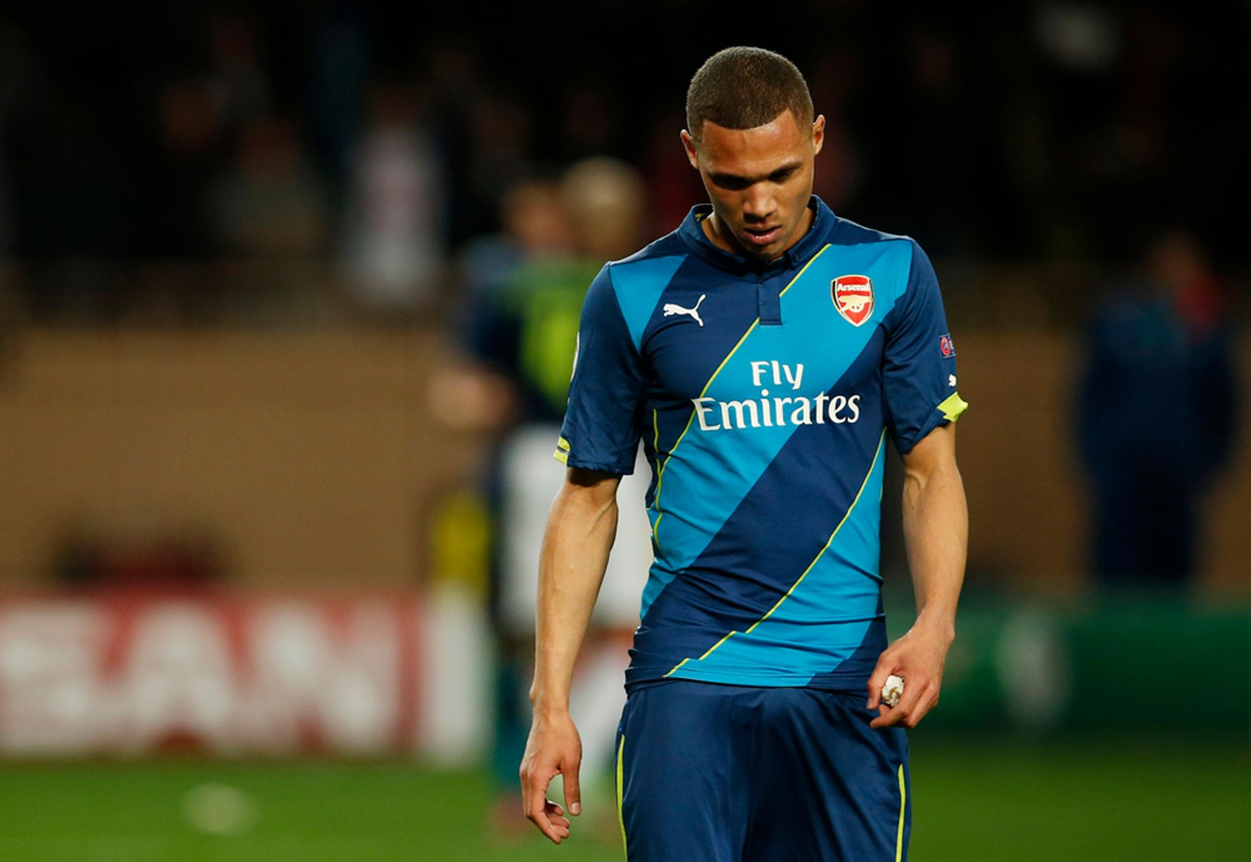 Kieran Gibbs looks dejected after the match