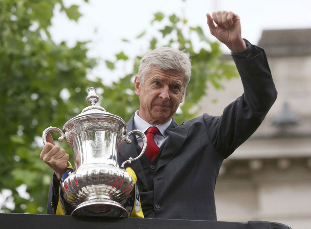 Arsene Wenger holds the trophy