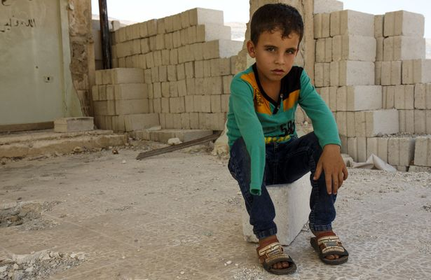 Khalid* age 7 who suffered severe injuries when his school was attacked in Northern Syria