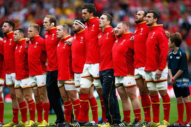 Sam Warburton of Wales sings the national anthem with team mates
