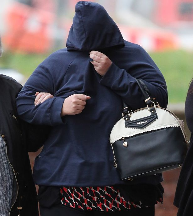 Hiding her face: Shelley Davies, 40, was found guilty of charges of conspiracy to procure prostitutes and false imprisonment