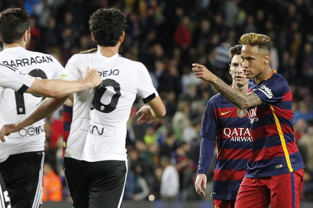 Neymar faces Antonio Barragan after the league match between Barcelona and Valencia on April 17, 2016
