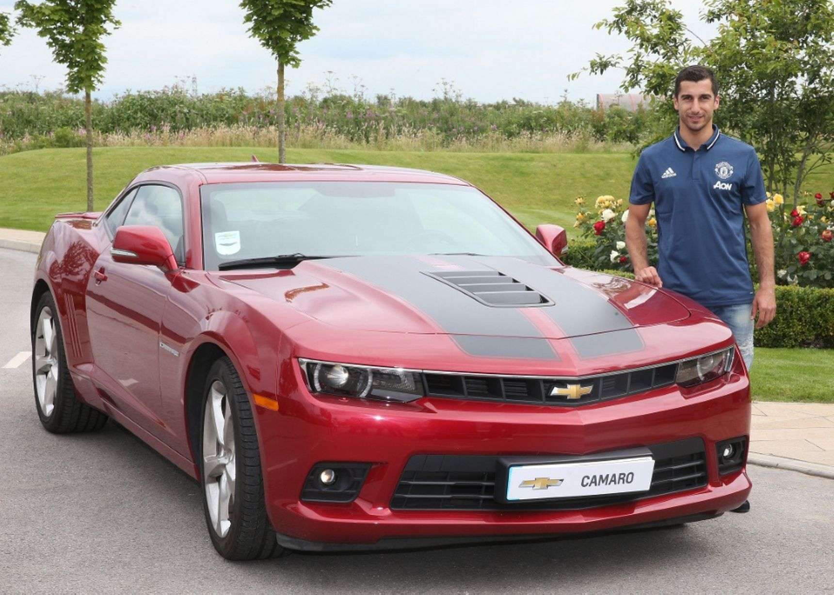 Henrikh Mkhitaryan of Manchester United poses with a Chevrolet car