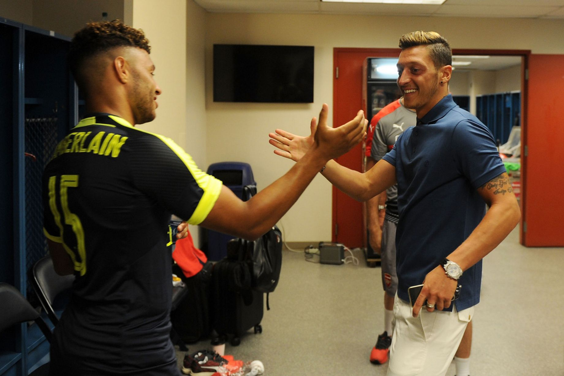 Alex Oxlade-Chamberlain and Mesut Ozil